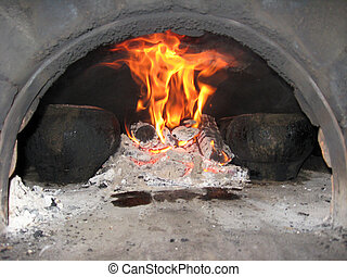 Flame in the furnace with pig-iron - the food cooking in the...