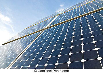 solar panels against a serene blue sky