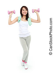 fitness woman with free weights - Portrait of Pretty happy...