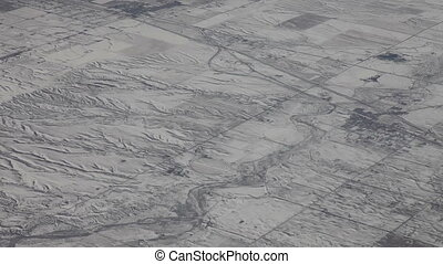 Flying above snowy flatland - Aerial view from an airplane...