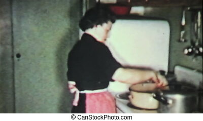 Woman Prepare Turkey Meal-1958 - A grandmother prepares a...