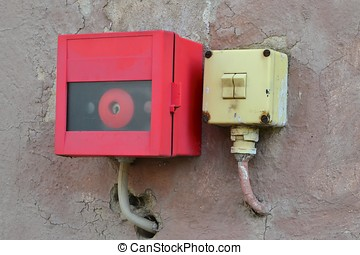 Light switch and alarm button on a house wall