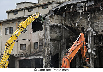 Building demolition - Machineries demolishing old industrial...