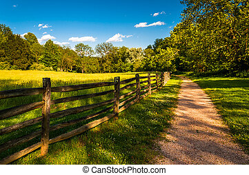 Dirt path and fence at Antietam National Battlefield,...