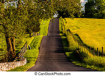 Fences and farm fields along a hilly road in Antietam...