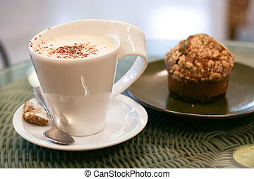 Coffee - Cup of coffee and a muffin.