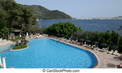The swimming pool and view on yachts harbor, Marmaris,...