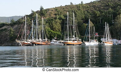 Yachts at the pier on Mediterranean turkish resort, Fethiye,...