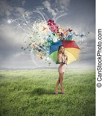 Creative fashion girl with colorful umbrella