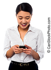 Woman sending text message to her colleague - Smiling woman...