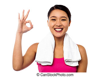 Smiling asian girl showing okay sign - Happy isolated young...