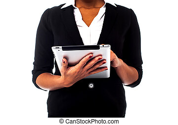 Cropped image of a woman holding touch pad - Woman working...