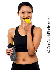 An apple a day keeps the doctor away - Young female athlete...