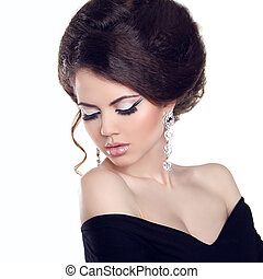 Beautiful woman with make-up and hairstyle Jewelry and...