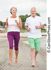 Active senior couple - Active and sporty senior couple at...