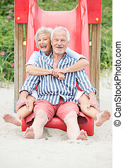 Active senior couple - Smiling an d happy senior couple at...