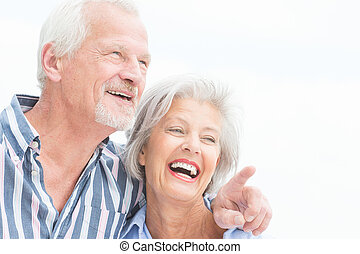 Happy senior couple - Portrait from a happy senior couple in...