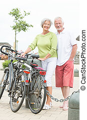 Active senior couple with bikes