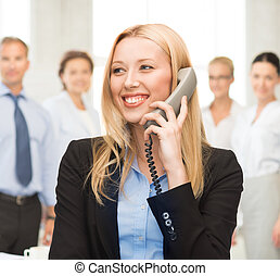 woman with phone in office