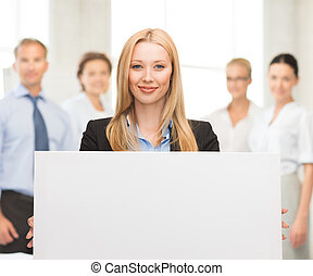 businesswoman with white blank board - smiling businesswoman...