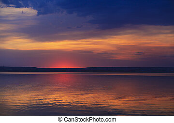 sunset over the lake - sunset with beautiful clouds over the...