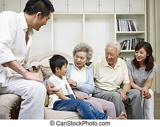 asian family - three-generation asian family talking in...