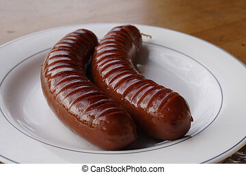 Sausage - Two hot sausages on the white plate