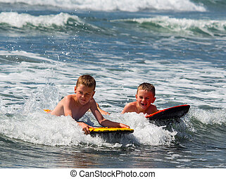 Two boys playing in surf