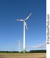 Wind turbines - Two wind turbines in field in Germany.