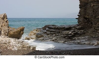 Waves crashing on the rocks on the beach at Agio Pavlos in...