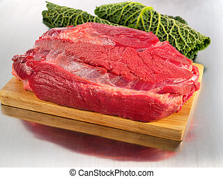 Raw beef flesh on cutting board
