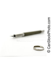 Divorce papers - Wedding ring and ink pen on divorce papers.