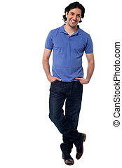 Handsome young man in casuals - Full length image of a smart...