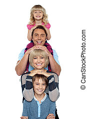 Young lovable happy family - Cheerful family of four...