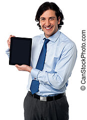 Sales manager displaying newly launched tablet pc - Sales...