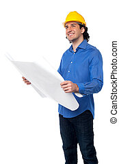 Construction worker reviewing blueprint - Architect with...