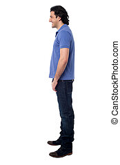 Side pose of smart young man, studio shot - Isolated young...