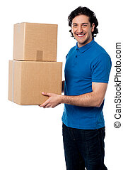 Smart young man carrying boxes - Handsome guy transferring...