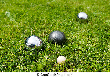 Bocce Balls - Bocce balls sitting in the green grass, close...