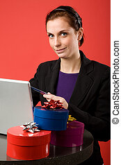 Online Christmas Shopping - A young female shopping for...
