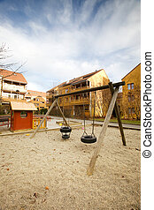 Swing Set - A swing set in a apartment block area