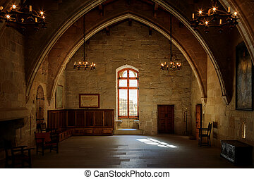 Dark old room in Poblet cloister with stained glass window...