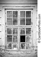 Old broken closed window in black and white