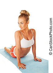 Shapely young woman doing press-ups
