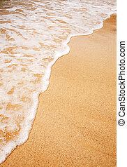 Wave Sand Background - A wave breaking on the sand -...