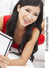 Asian Chinese Woman Using Tablet Computer