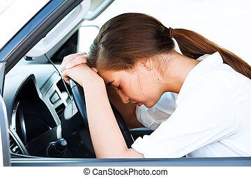 Girl sleeps in a car