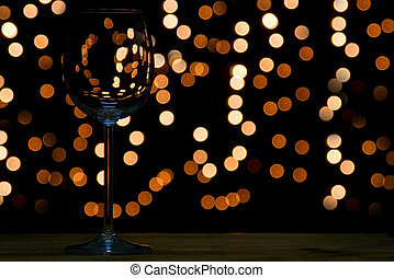 Wine glass on wooden table with dark and bokeh background...