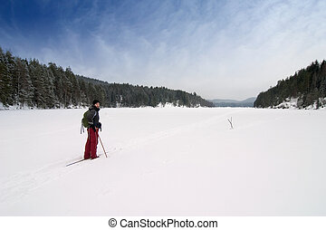 Cross Country Skiing - A cross country skiier out on a...