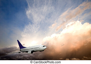 Airplane Sunset - An airliner flying into the sunset